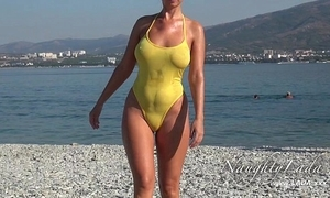 Abrupt straight away wet swimwear added to flashing