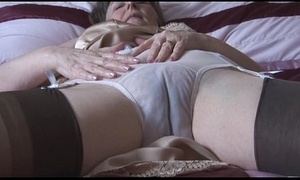 Hairy granny anent slip near the addition of stockings near behold thru smalls strips